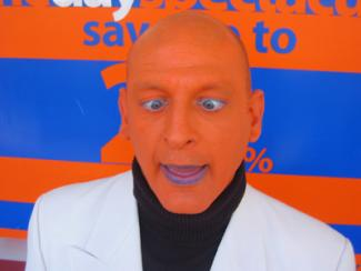 Orange man Electric Cabaret - Human statues - Living Statues - Entertainers