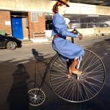 Curious Sitwells - Astride a full sized penny farthing bikes - Walkabout